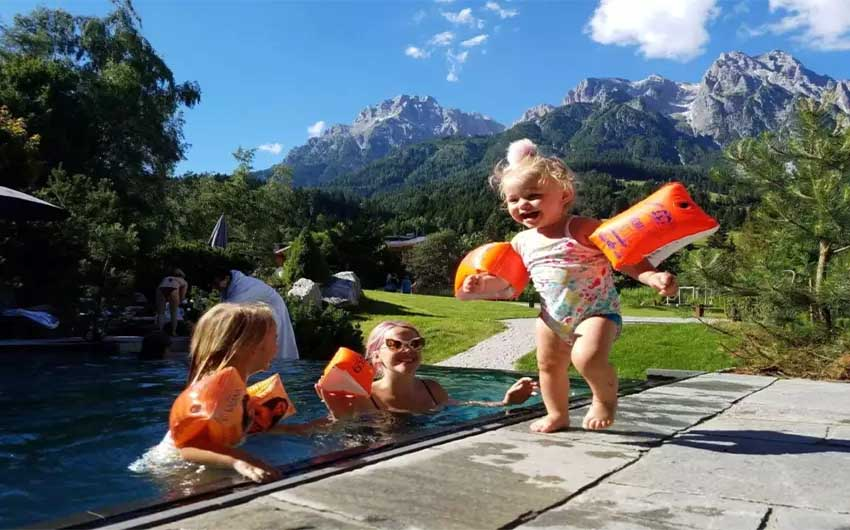 Children Enjoying Swimming at the Hotel with The Little Voyager