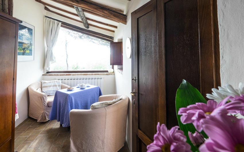 The Umbrian Country Cottages Stalla Dining Room with The Little Voyager