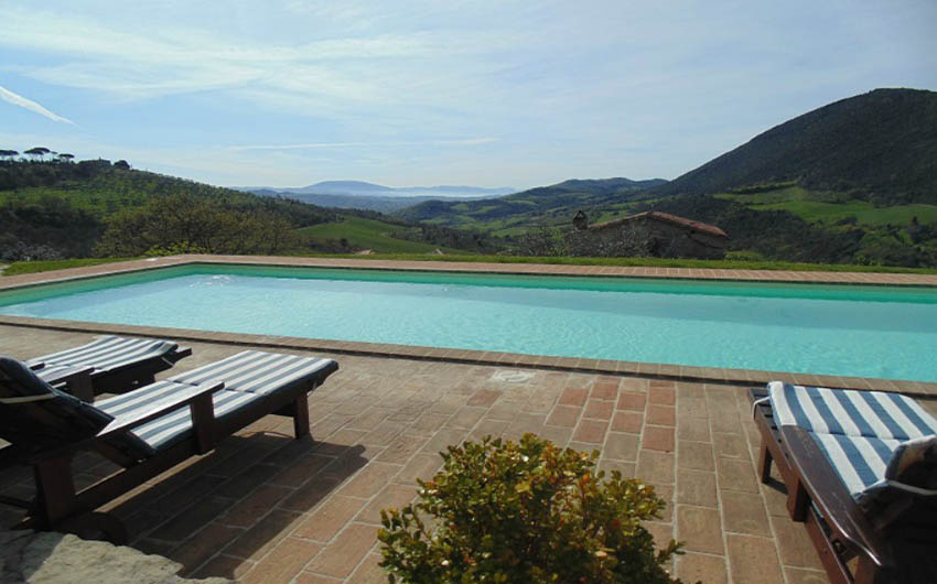Umbrian Cottages Swimming Pool with The Little Voyager