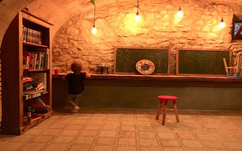 Catalan Farmhouse Playroom with The Little Voyager