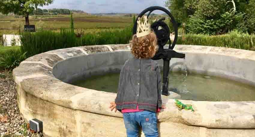 A French Chateau's Fountain with The Little Voyager