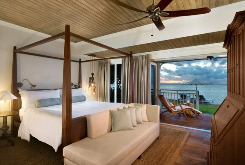 Room with large bed and ocean view