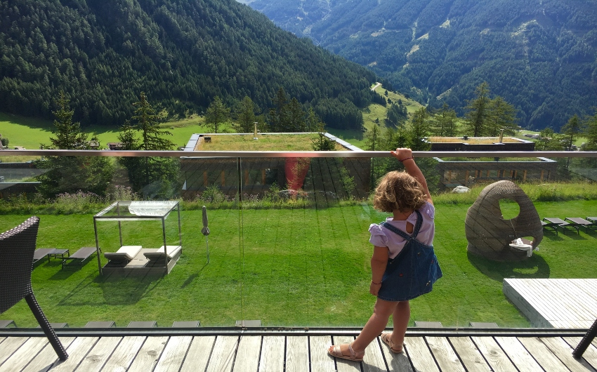 Child looking at green fields