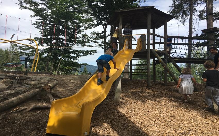 Boy climbing up a slide