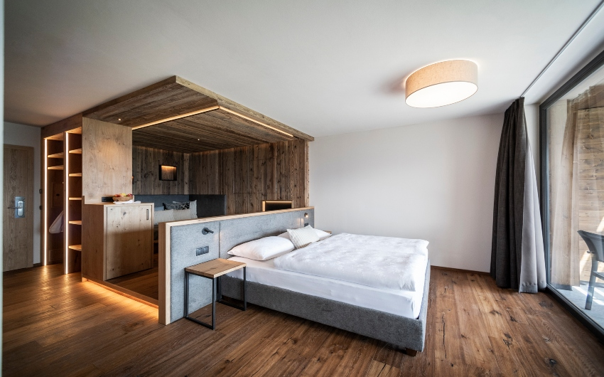 Bed inside a suite at the South Tyrolean Panorama Retreat