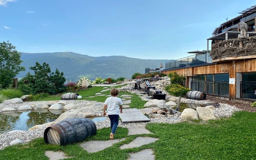 Boy walking on the grounds of the South Tyrolean Panorama Retreat
