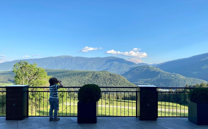 Boy using binoculars at the South Tyrolean Panorama Retreat