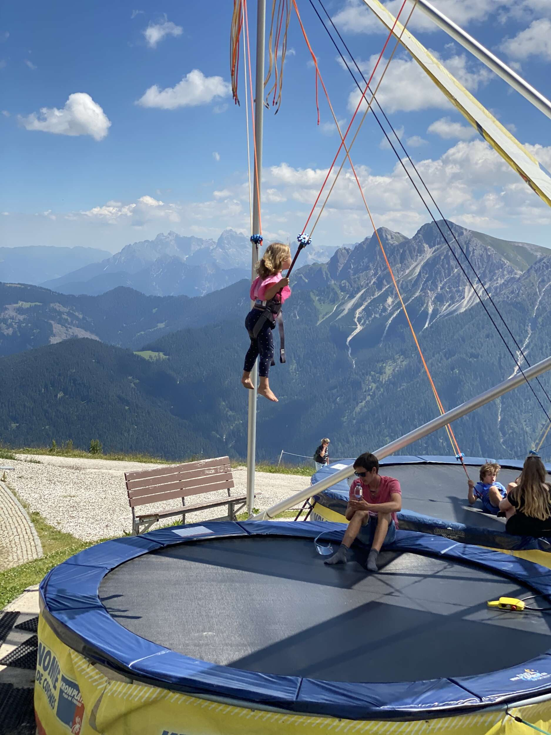 Girl on giant trampoline bungeejumping
