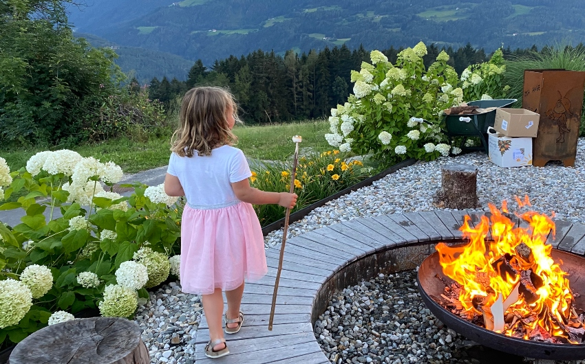 Girl with marshmallow on a stick at the South Tyrolean Panorama Retreat