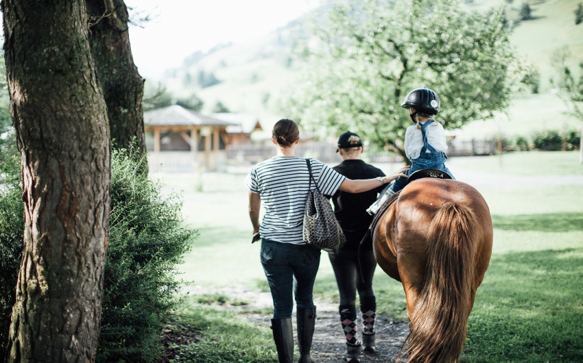Kid riding a horse at the Austrian Nature Retreat